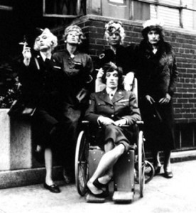 What a DRAG it is getting old > the Rolling Stones play dress-up on cover of single Have You Seen Your Mother, Baby, Standing In the Shadow > September 1966. A wheelchaired Bill Wyman [no, he wasn't really disabled]; guitarist Brian Jones with a fag; grandma Keith Richards; Mick Jagger still doing his best to look beautiful and a decidedly uncomfortable Charlie Watts..